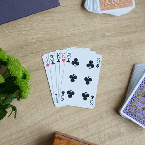 Playing cards fanned on a wooden surface