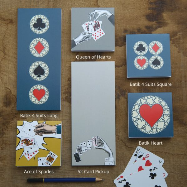 playing card themed notepads on wood with titles